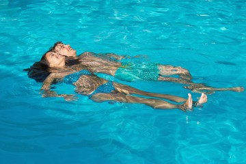 Relaxed young couple in swimming pool