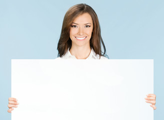 Businesswoman showing signboard, over blue