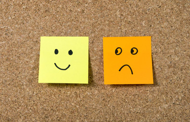 post it notes smiley and sad face happiness vs depression