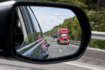 Interstate Traffic In The Rear View Mirror