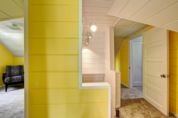 Upstairs hallway with bright yellow wall