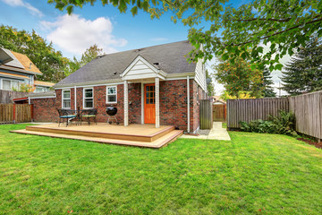 Brick house exterior with walkout wooden deck