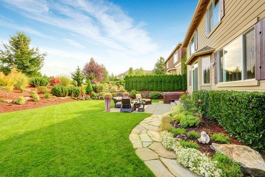 Luxury house exterior with impressive backyard landscape design