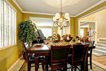 Luxury house interior. Served dining table in bright room