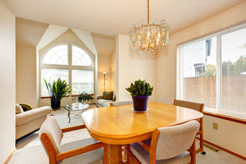 Bright dining area with maple table in luxury house