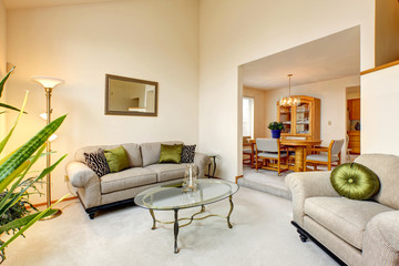 Luxury family room in soft creamy tones and maple dining table s
