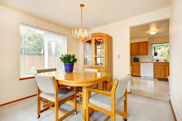 Bright dining area with maple furniture