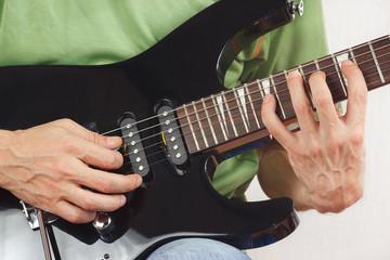 Hands of guitarist put guitar chords closeup