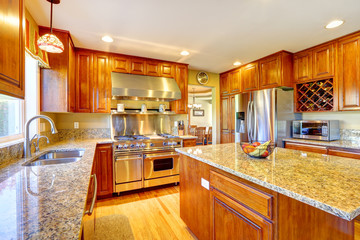 Shiny luxury kitchen room with island