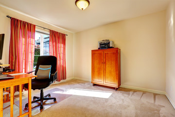 Simple office room with wooden cabinet