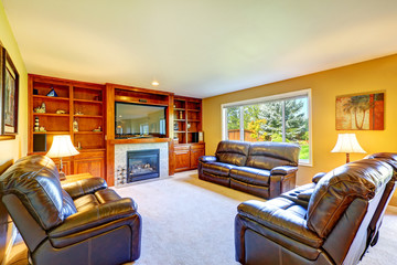 Family room with rich leather furniture set