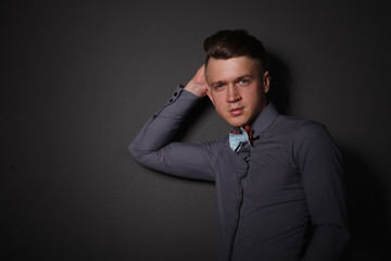 Portrait of a young man standing,isolated on grey background