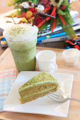 piece of green tea cake and cool green tea ice in glass bottle a