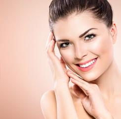 Beauty teenage model girl portrait over pink background