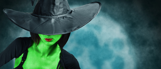 Beautiful witch with green skin