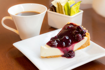 Bluberry pie with coffee on woodern table