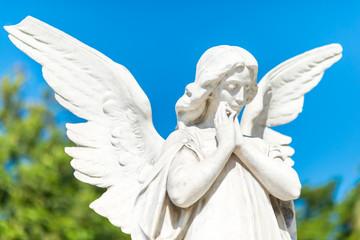 Beautiful angel on a clear blue sky