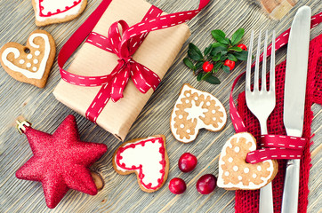 Christmas table setting with christmas decorations and gingerbre