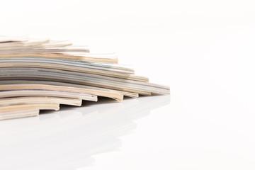 Сolorful magazines up close shot on white background