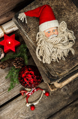 christmas decoration with antique toys on wooden background