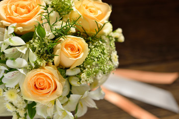 Beautiful bouquet of flowers on wooden background