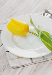 Spring table settings with fresh tulips
