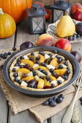 Tart with peach, pumpkin, plum, pear and blueberry