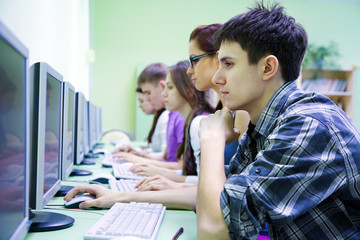group of students studying with computer