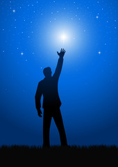 Silhouette of a male figure reaching out for the star