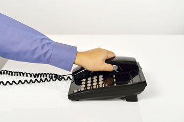 Man Using A Telephone