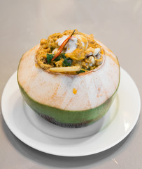steamed fish and seafood in fresh coconut