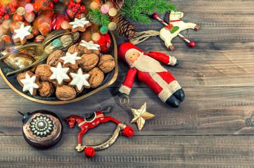 christmas cookies and vintage decorations. defocused lights
