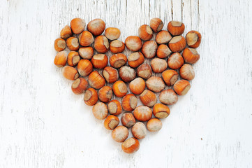 heart shape made of hazelnuts
