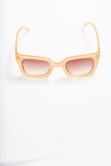 Sunglasses on white background, space for text