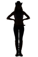 Silhouette of young cowgirl - hands on waist