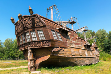 Abandoned old wooden sailing ship on shore