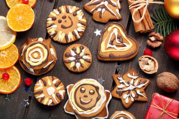 Christmas decoration with gingerbread on wooden background