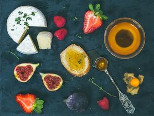 Cheese, fresh strawberries, figs, raspberries, ground cherry, th