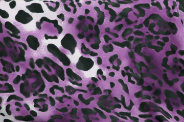 Beautiful purple animal print leopard background / wallpaper