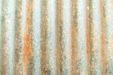 Rusted, galvanized, corrugated iron siding, vintage background.