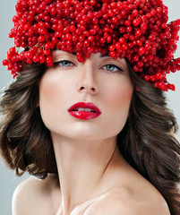 beautiful woman in hat of red berries