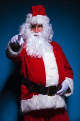 Santa Claus pointing at the camera