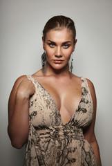 Sensual female model in formal dress posing to camera