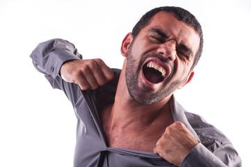 man screaming and ripping his shirt