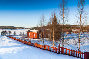 Winter landscape with house at lake in Scandinavia