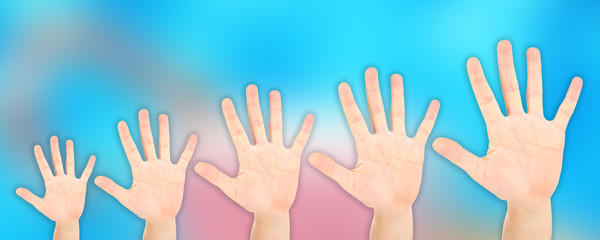 People's hands on bright background