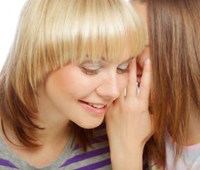 girl whispering secrets in her mommy's ear