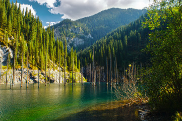 Kaindy Lake in Tien Shan mountain, Kazakhstan. Autumn