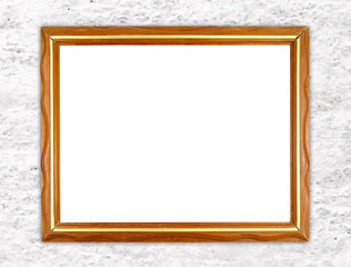 blank wood frame on stone cement wall
