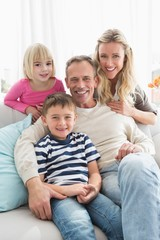 Portrait of a cheerful family on the couche